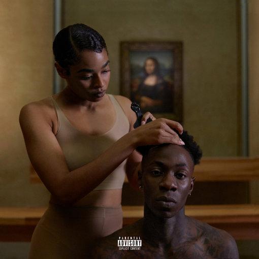 """""""Apeshit""""を収録したアルバム『Everything Is Love』ジャケット。男性の髪をとかす女性の背後に『モナ・リザ』が見える"""