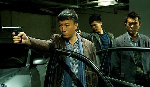 手を組んで捜査をすることになるジャン警部(スン・ホンレイ)とテンミン(ルイス・クー) 『ドラッグ・ウォー 毒戦』 ©2012 Beijing Hairun Pictures Co., Ltd. All Rights Reserved.
