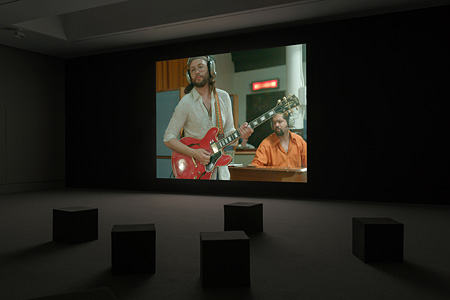 Installation view of Stan Douglas, Luanda-Kinshasa, 2013. Single-channel video projection, 6 hr. 1 min. (loop), color, sound