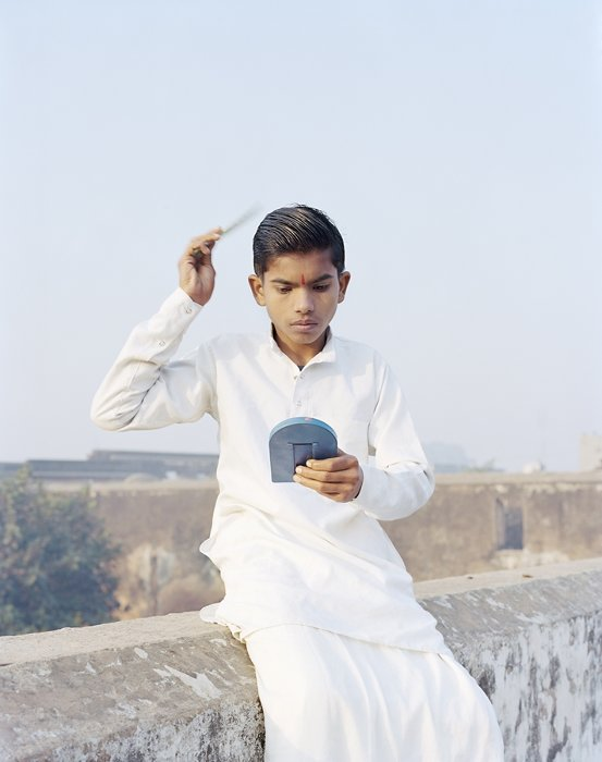 Rama Combing His Hair, Ayodhya, India, 2015 ©Vasantha Yogananthan