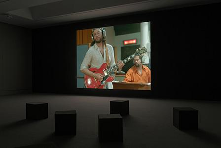 Installation view of Stan Douglas, Luanda-Kinshasa, 2013. Single-channel video projection, 6 hr. 1 min. (loop), color, sound